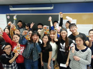 Chinese students celebrating Halloween with makeshift trick-or-treating.